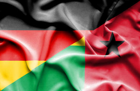 bissau: Waving flag of Guinea Bissau and
