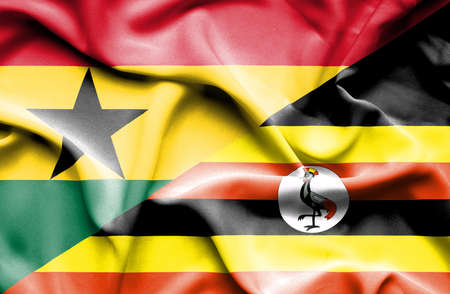 uganda: Waving flag of Uganda and Ghana Stock Photo