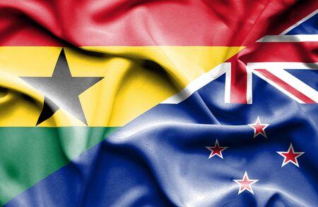 bandera de nueva zelanda: Ondeando la bandera de Nueva Zelanda y Ghana Foto de archivo