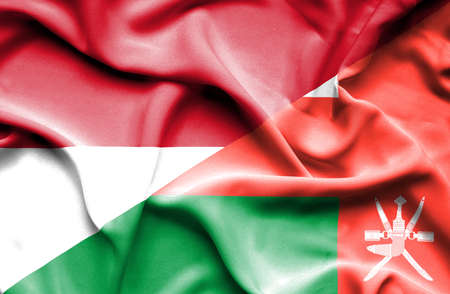 national flag indonesian flag: Waving flag of Oman and Indonesia Stock Photo