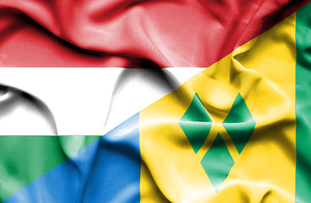 grenadines: Waving flag of Saint Vincent and Grenadines and Hungary Stock Photo