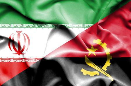 angola: Waving flag of Angola and Iran Stock Photo