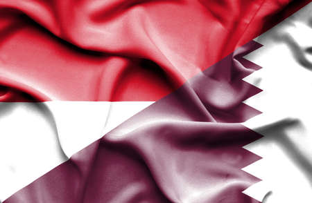national flag indonesian flag: Waving flag of Qatar and Indonesia