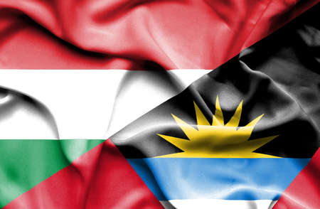 antigua: Waving flag of Antigua and Barbuda and Hungary Stock Photo