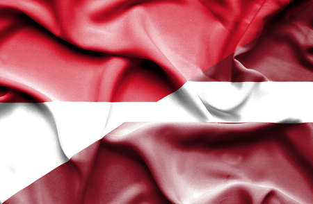 national flag indonesian flag: Waving flag of Latvia and Indonesia Stock Photo