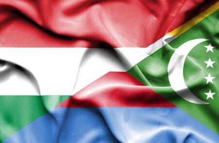 comoros: Waving flag of Comoros and Hungary Stock Photo