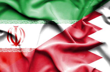 bahrain: Waving flag of Bahrain and Iran Stock Photo