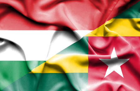 togo: Waving flag of Togo and Hungary Stock Photo