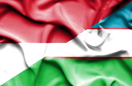 uzbekistan: Waving flag of Uzbekistan and Indonesia Stock Photo