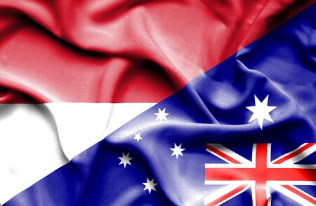 national flag indonesian flag: Waving flag of Australia and Indonesia Stock Photo