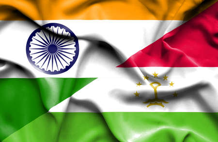 economy of tajikistan: Waving flag of Tajikistan and
