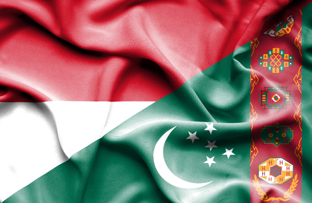 national flag indonesian flag: Waving flag of Turkmenistan and Indonesia