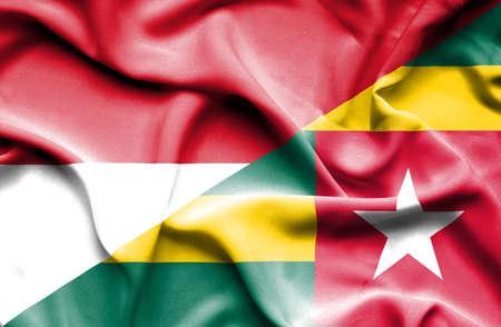 togo: Waving flag of Togo and Indonesia