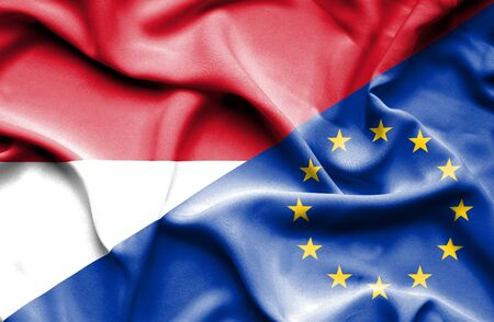 national flag indonesian flag: Waving flag of European Union and Indonesia Stock Photo