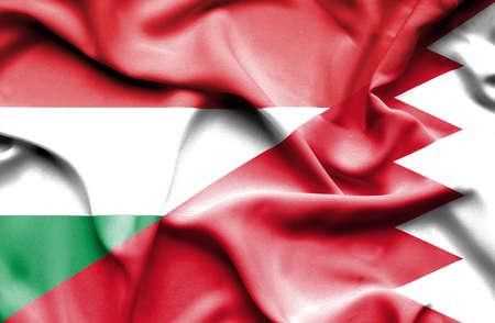bahrain money: Waving flag of Bahrain and Hungary Stock Photo