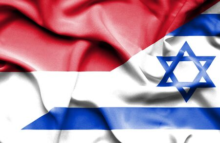 national flag indonesian flag: Waving flag of Israel and Indonesia Stock Photo