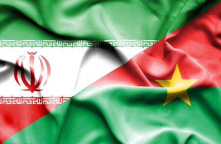 iran: Waving flag of Burkina Faso and Iran Stock Photo