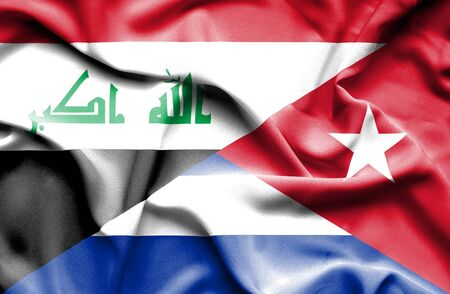 iraq conflict: Waving flag of Cuba and Iraq