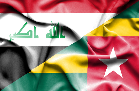 iraq conflict: Waving flag of Togo and Iraq