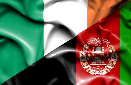 irish history: Waving flag of Afghanistan and Ireland Stock Photo