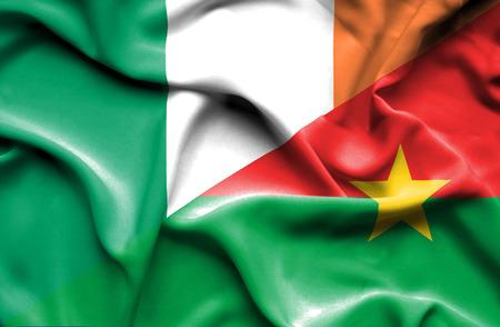 burkina faso: Waving flag of Burkina Faso and Ireland