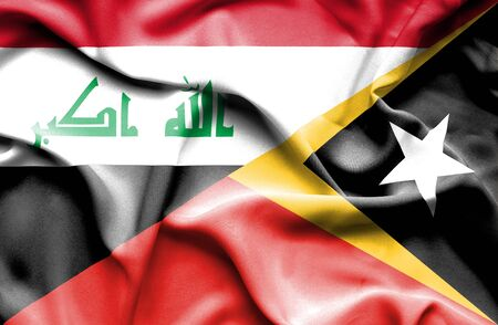 iraq conflict: Waving flag of East Timor and Iraq Stock Photo
