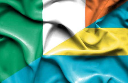 irish history: Waving flag of Bahamas and Ireland Stock Photo