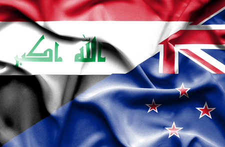 iraq money: Waving flag of New Zealand and Iraq