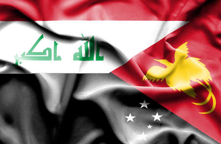 iraq war: Waving flag of Papua New Guinea and Iraq Stock Photo