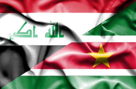 iraq conflict: Waving flag of Suriname and Iraq