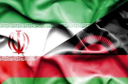 malawian flag: Waving flag of Malawi and Iran Stock Photo