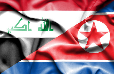 iraq money: Waving flag of North Korea and Iraq Stock Photo