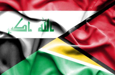 iraq war: Waving flag of Guyana and Iraq