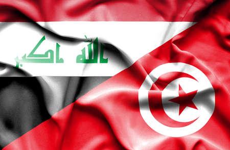 iraq conflict: Waving flag of Tunisia and Iraq Stock Photo