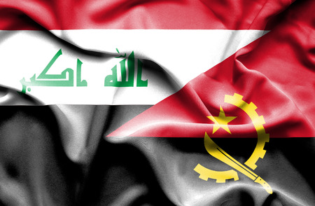 iraq conflict: Waving flag of Angola and Iraq
