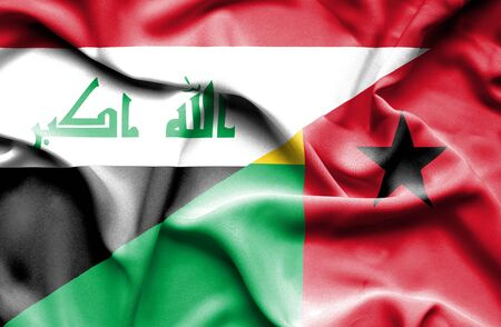 iraq conflict: Waving flag of Guinea Bissau and Iraq