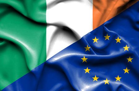 european union: Waving flag of European Union and Ireland Stock Photo