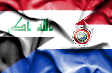 iraq conflict: Waving flag of Paraguay and Iraq