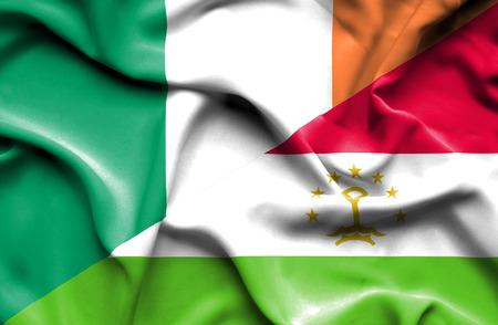 tajikistan: Waving flag of Tajikistan and Ireland