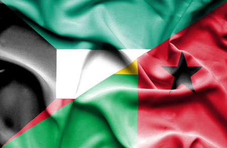 guinea bissau: Waving flag of Guinea Bissau and Kuwait Stock Photo