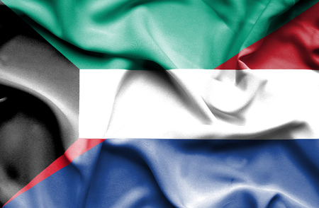 dutch culture: Waving flag of Netherlands and Kuwait Stock Photo