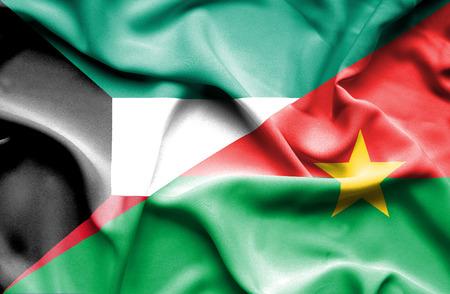 burkina faso: Waving flag of Burkina Faso and Kuwait Stock Photo