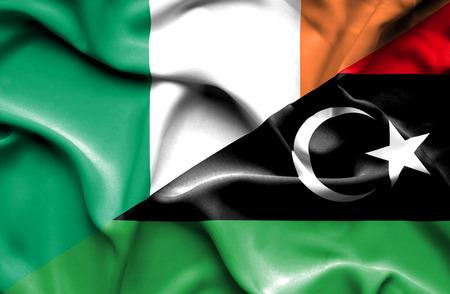 ireland flag: Waving flag of Libya and Ireland Stock Photo