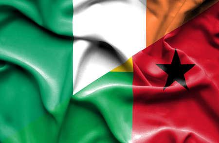 guinea bissau: Waving flag of Guinea Bissau and Ireland Stock Photo