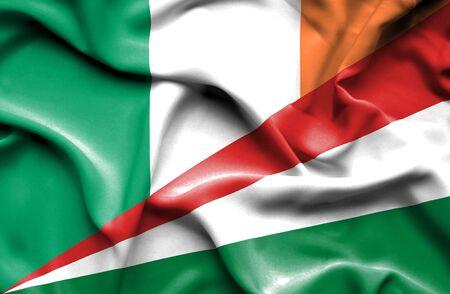 ireland flag: Waving flag of Seychelles and Ireland Stock Photo