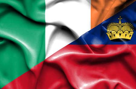 irish history: Waving flag of Lichtenstein and Ireland Stock Photo