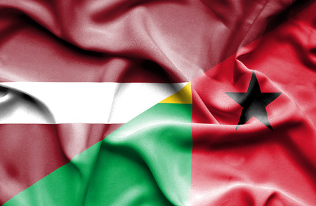 guinea bissau: Waving flag of Guinea Bissau and Latvia