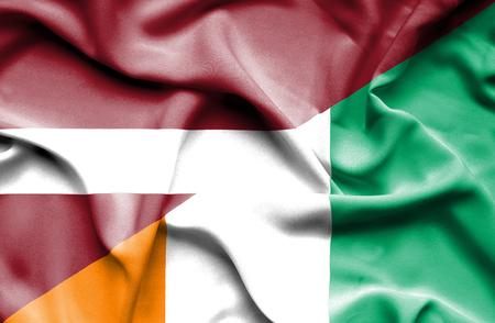 coast: Waving flag of Ivory Coast and Latvia