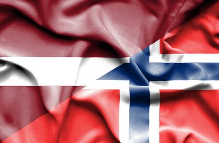 latvia: Waving flag of Norway and Latvia Stock Photo