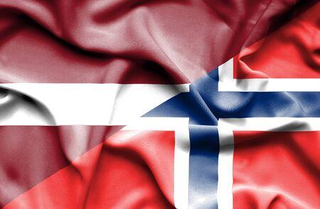 norway flag: Waving flag of Norway and Latvia Stock Photo